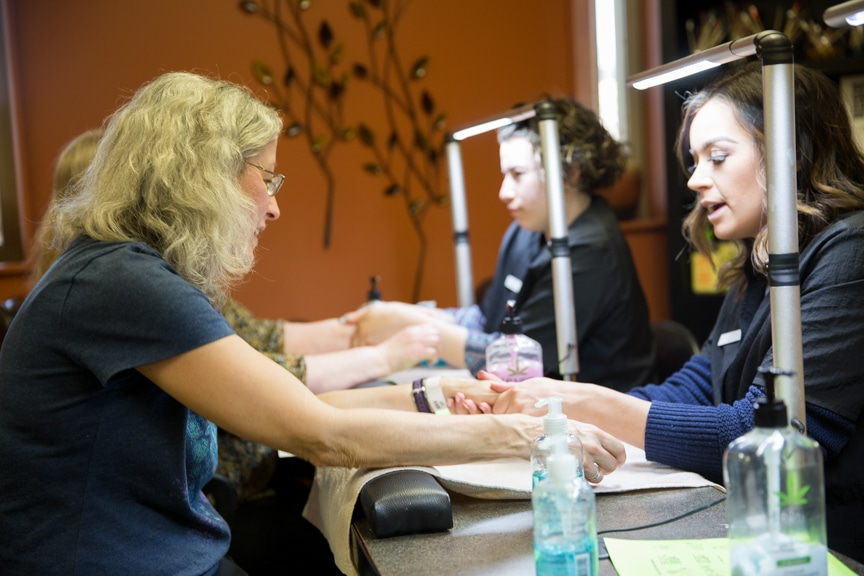 Women receiving manicures at Moraine Park Open House