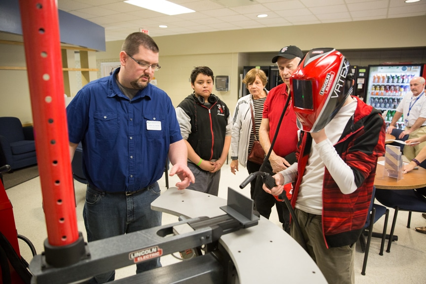 Man simulating welding machine at Moraine Park Open House