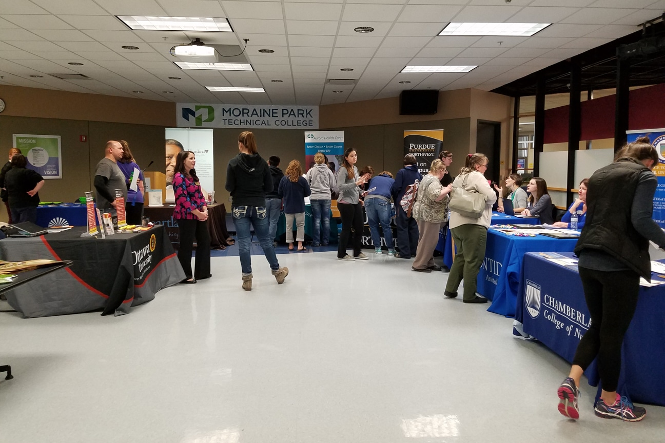 tables line the walls of moraine park cafeteria for healthcare career fair