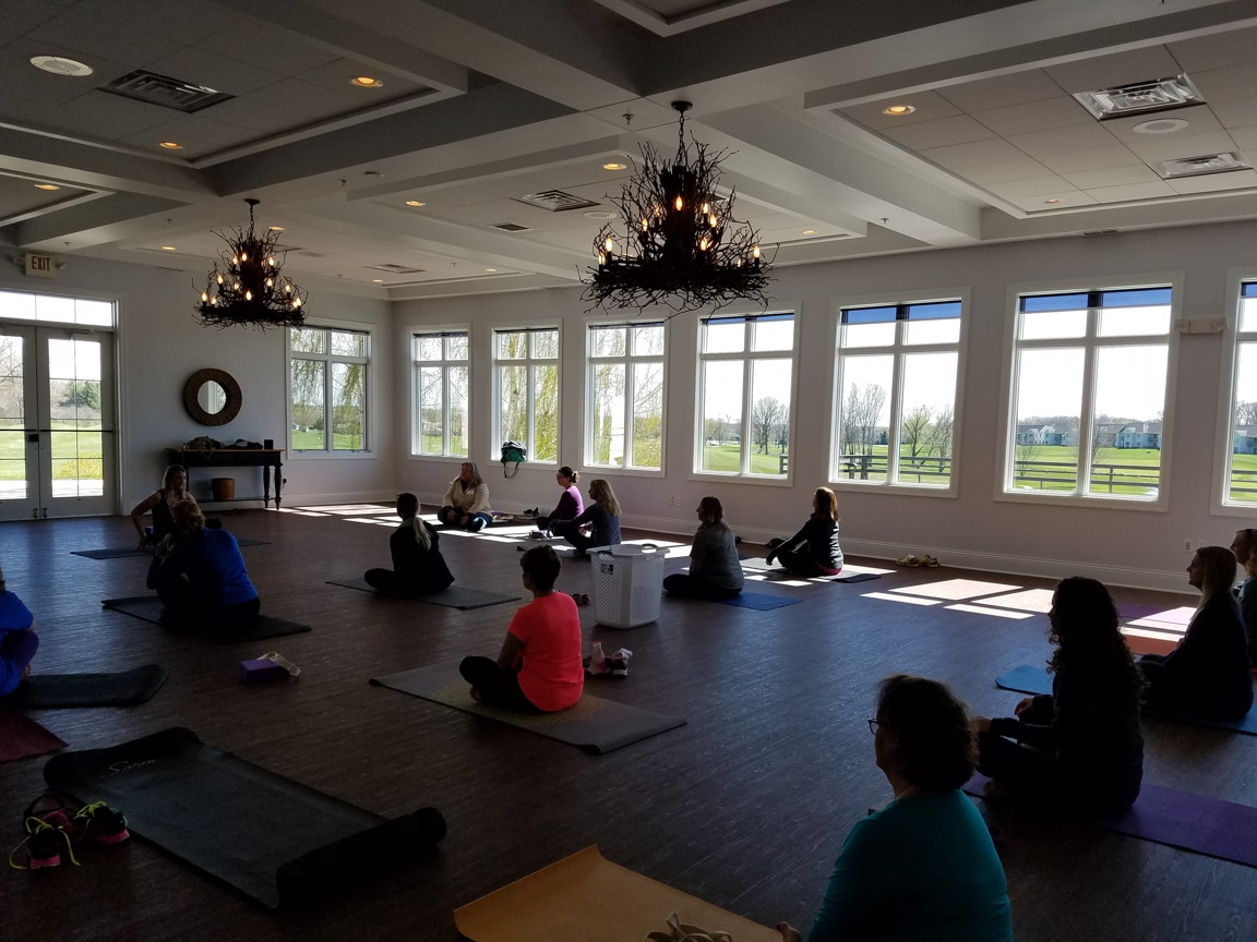 women rest on yoga mats during Wisconsin Women in Higher Education Leadership workshop