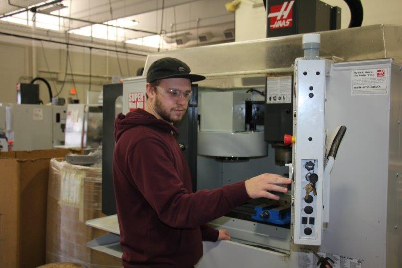 alex works with cnc machine at moraine park