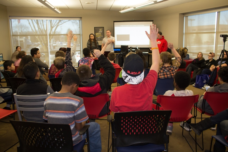 attendees raise hands for questions at stay out of traffic event