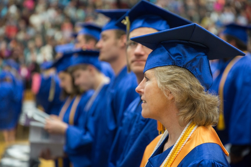 Graduate stares toward stage at Moraine Park commencement ceremony