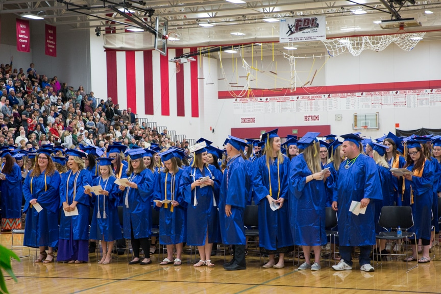 Graduates stand in large group at Moraine Park commencement ceremony