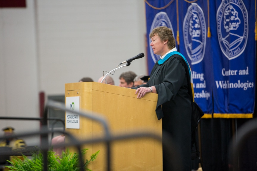 President Bonnie Baerwald speaks from podium at Moraine Park commencement ceremony