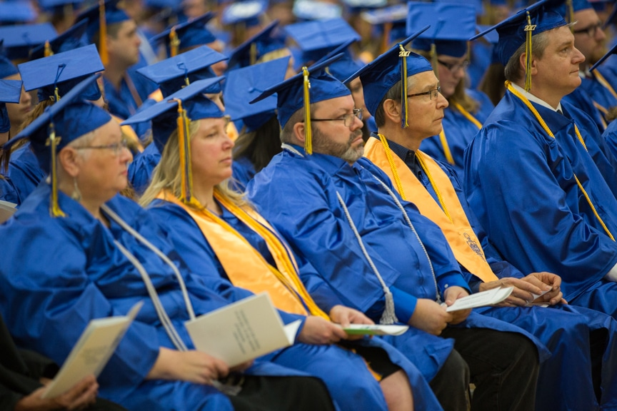 Graduates sit together at Moraine Park commencement ceremony