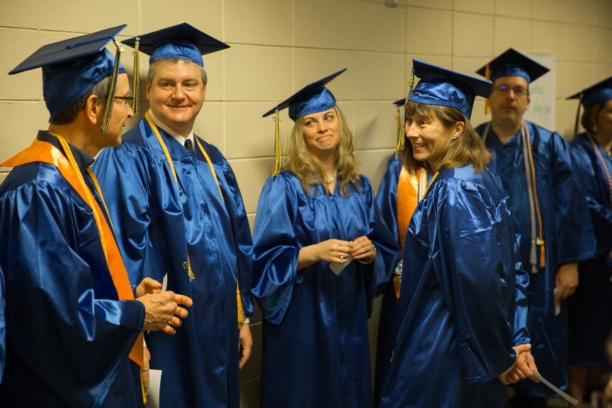Graduates talking in hallway prior to Moraine Park commencement ceremony