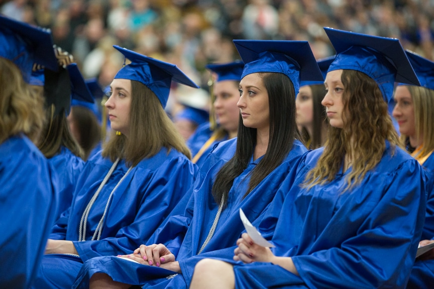 Female graduates sit in rows at Moraine Park commencement ceremony