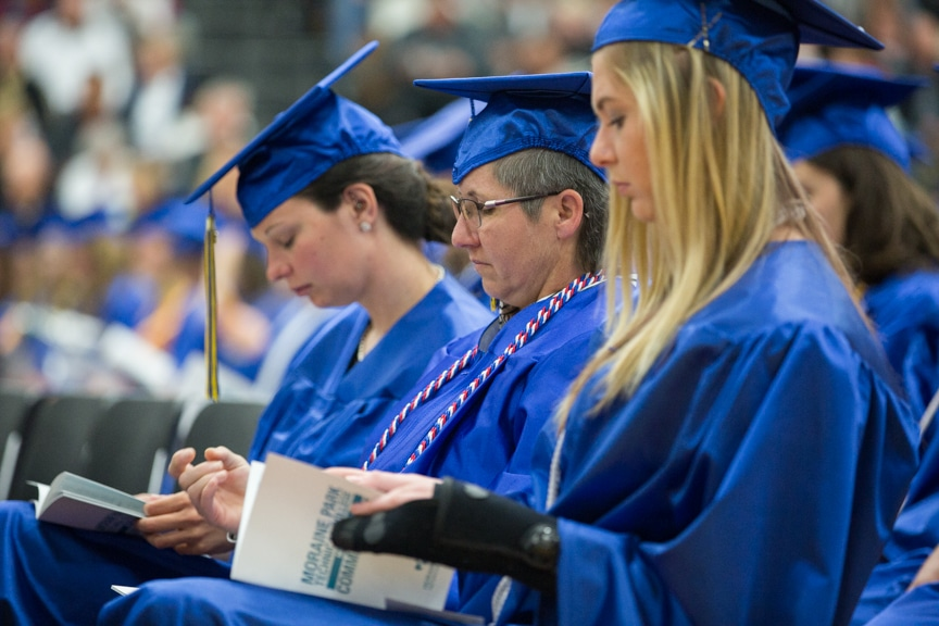 Graduates sit in caps and gowns at Moraine Park commencement ceremony