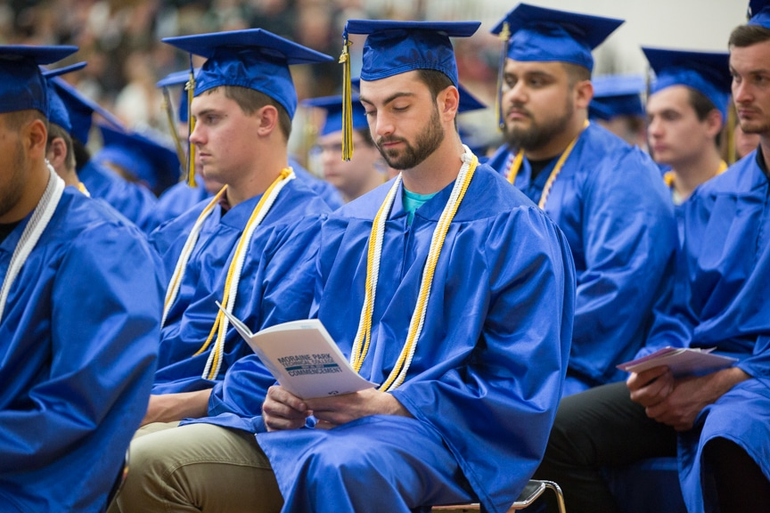 Graduates sit in rows at Moraine Park commencement ceremony