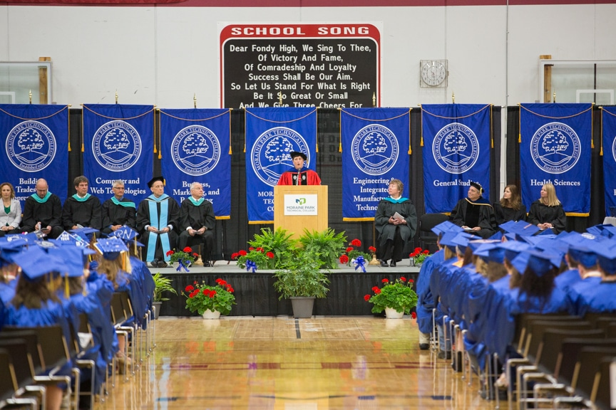 Morna Foy speaks from podium at Moraine Park commencement ceremony