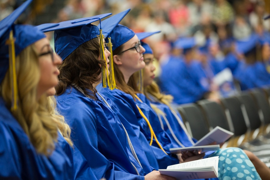 Row of graduates listen to speech at Moraine Park commencement ceremony