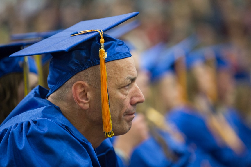 Male graduate listens stoically at Moraine Park commencement ceremony