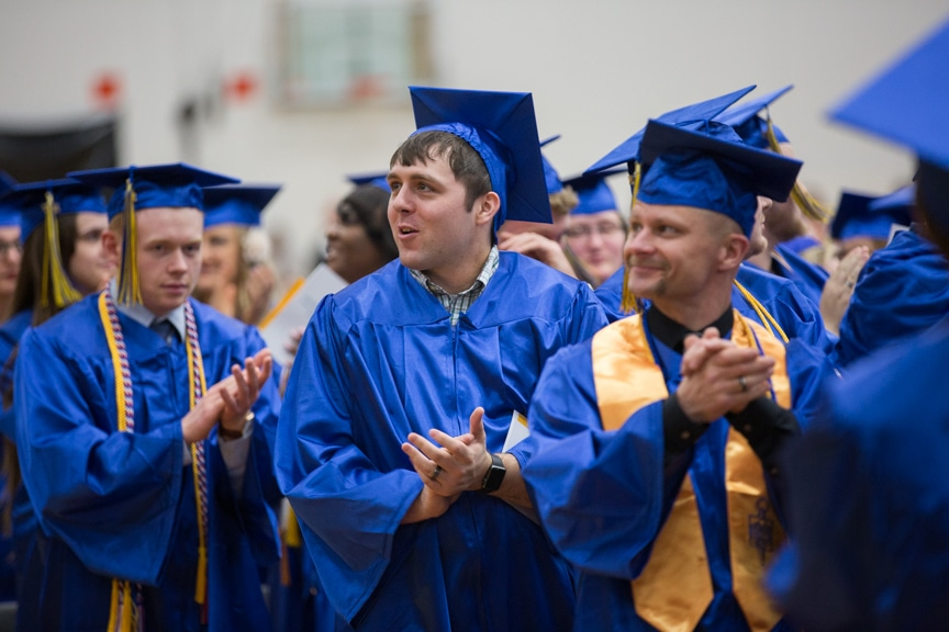 Gaduates give round of applause at Gradutes sit at Moraine Park commencement ceremony