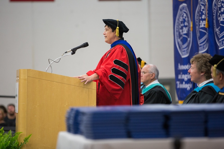 Morna Foy speaks from podium at Gradutes sit at Moraine Park commencement ceremony