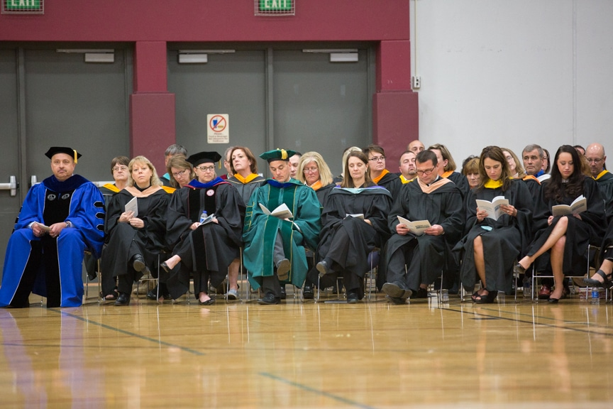 Staff members seated in rows at Moraine Park commencement ceremony