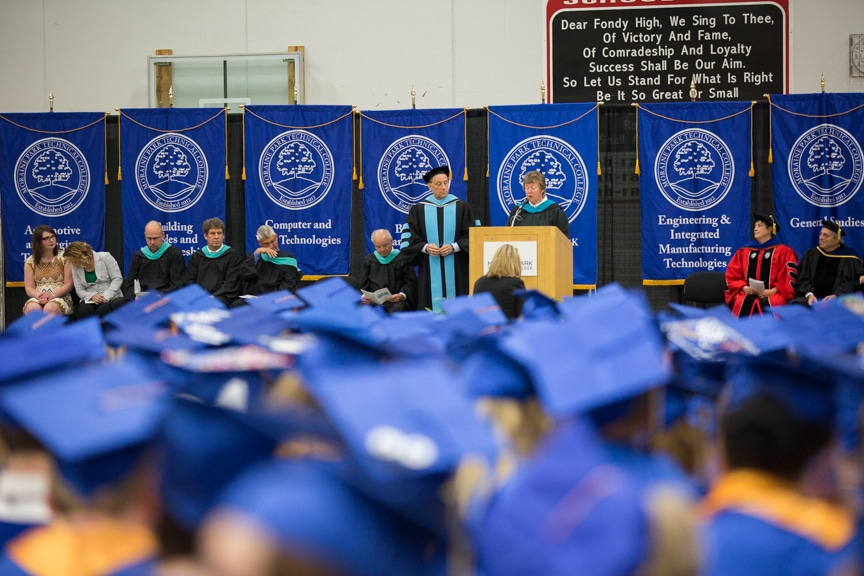 President Bonnie Baerwald speaks at podium during Moraine Park commencement ceremony
