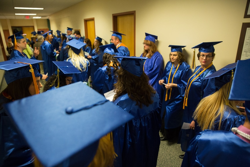 Group of graduates gathering in hallway before Moraine Park commencement ceremony