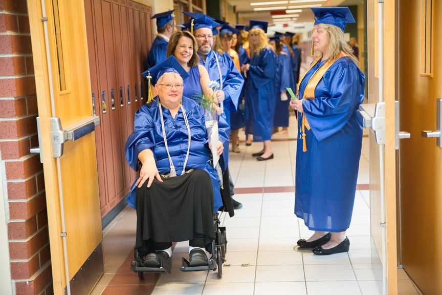 Graduates talking in halways before Moraine Park commencement ceremony