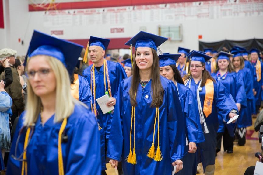 Graduates marching down aisle at Moraine Park commencement ceremony