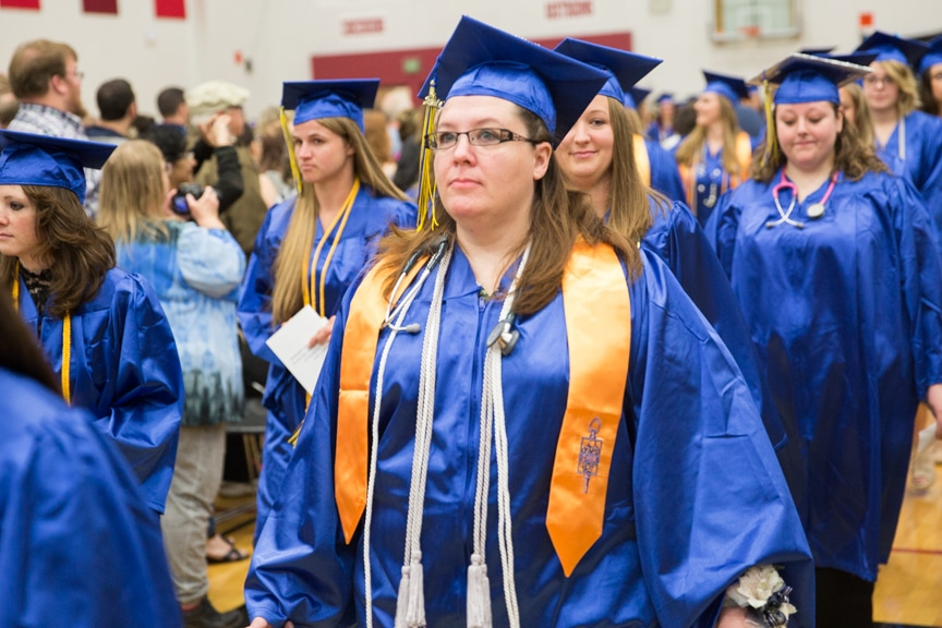 Female gradaute marches down aisle at Moraine Park commencement ceremony