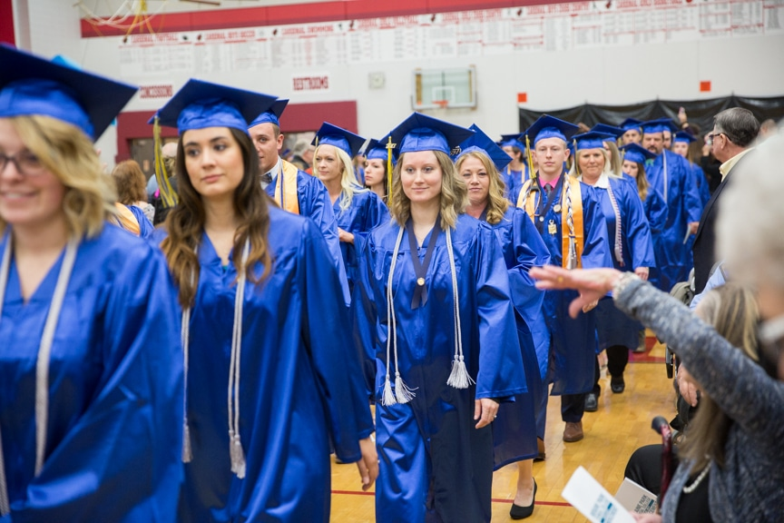 A long line of graduates march in together at start of Moraine Park commencement ceremony