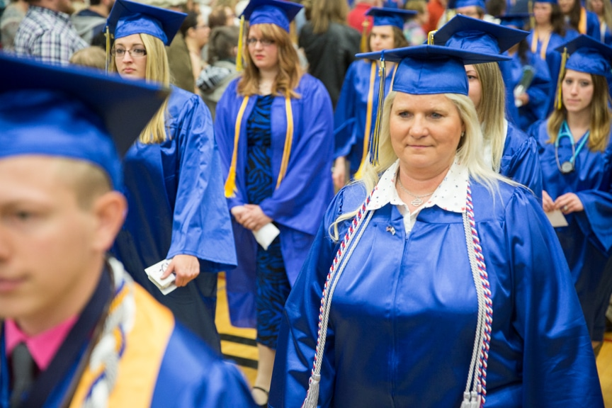 Female student marches in at start of Moraine Park commencement ceremony