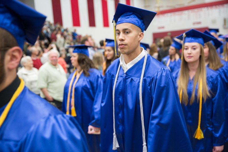 Male student marches in at start of Moraine Park commencement ceremony