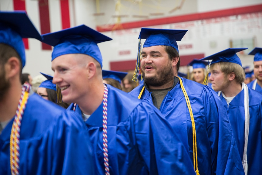 Male students march in at Moraine Park commencement ceremony