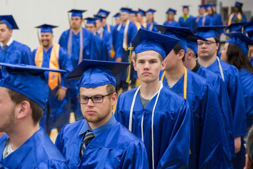 Male graduates march down asile at Moraine Park commencement ceremony