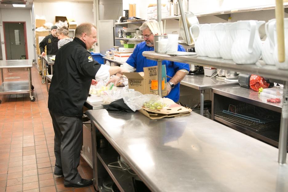 Brakebush setting up appetizer for Gourmet Dinner
