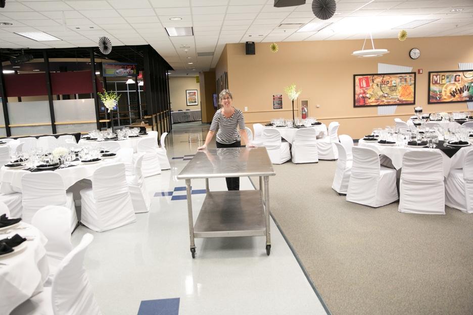 Moraine Park Admin Aide Debbie Ritger volunteering for set-up of Gourmet Dinner