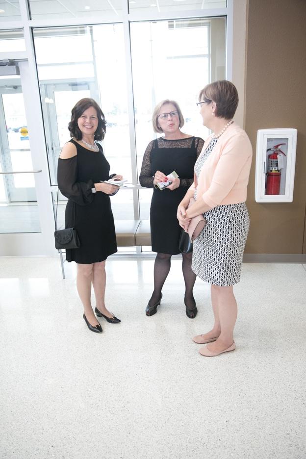 Moraine Park Foundation Gourmet Dinner attendees talking in lobby