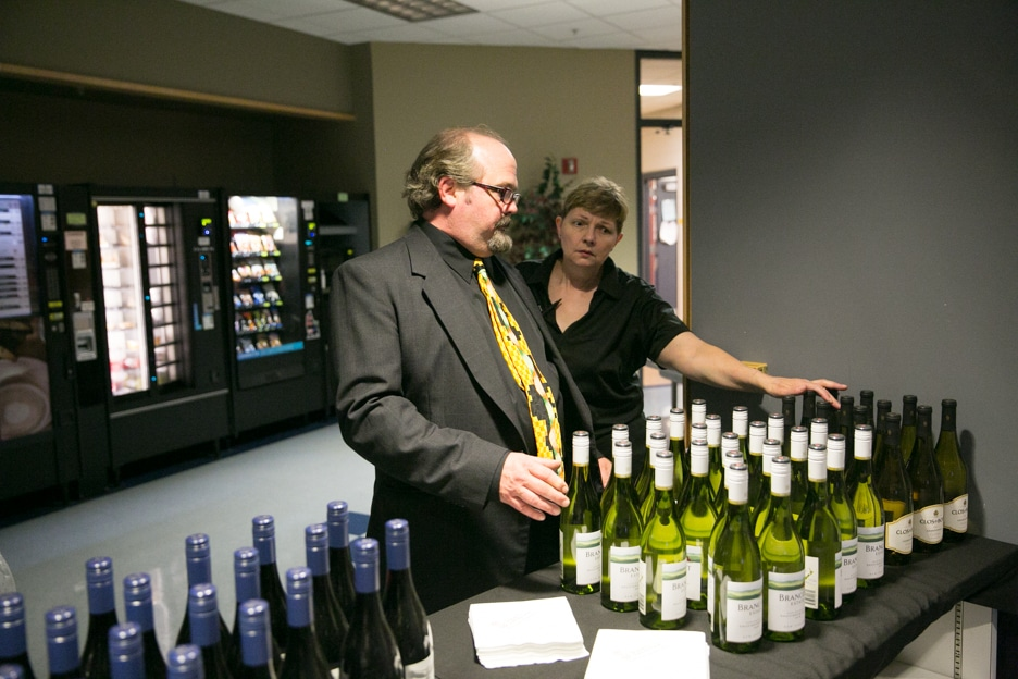 Culinary instructors setting up wine for Gourmet Dinner