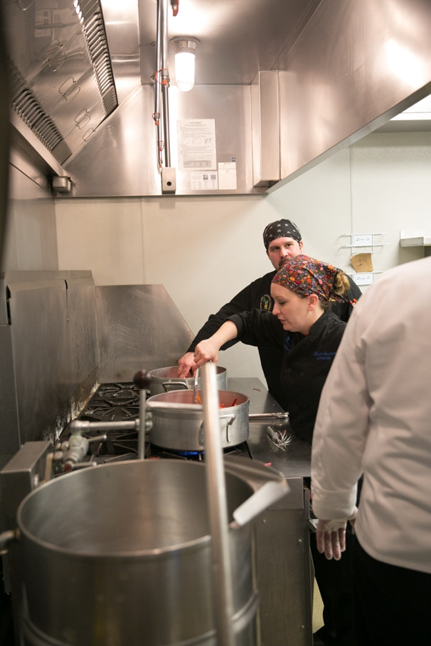culinary staff preparing food at Gourmet Dinner