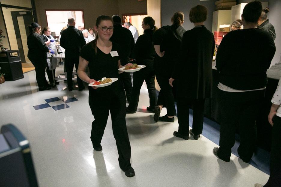 Moraine Park Foundation Gourmet Dinner volunteers serving food