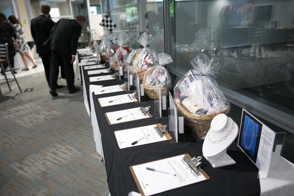 Gourmet Dinner silent auction items on table