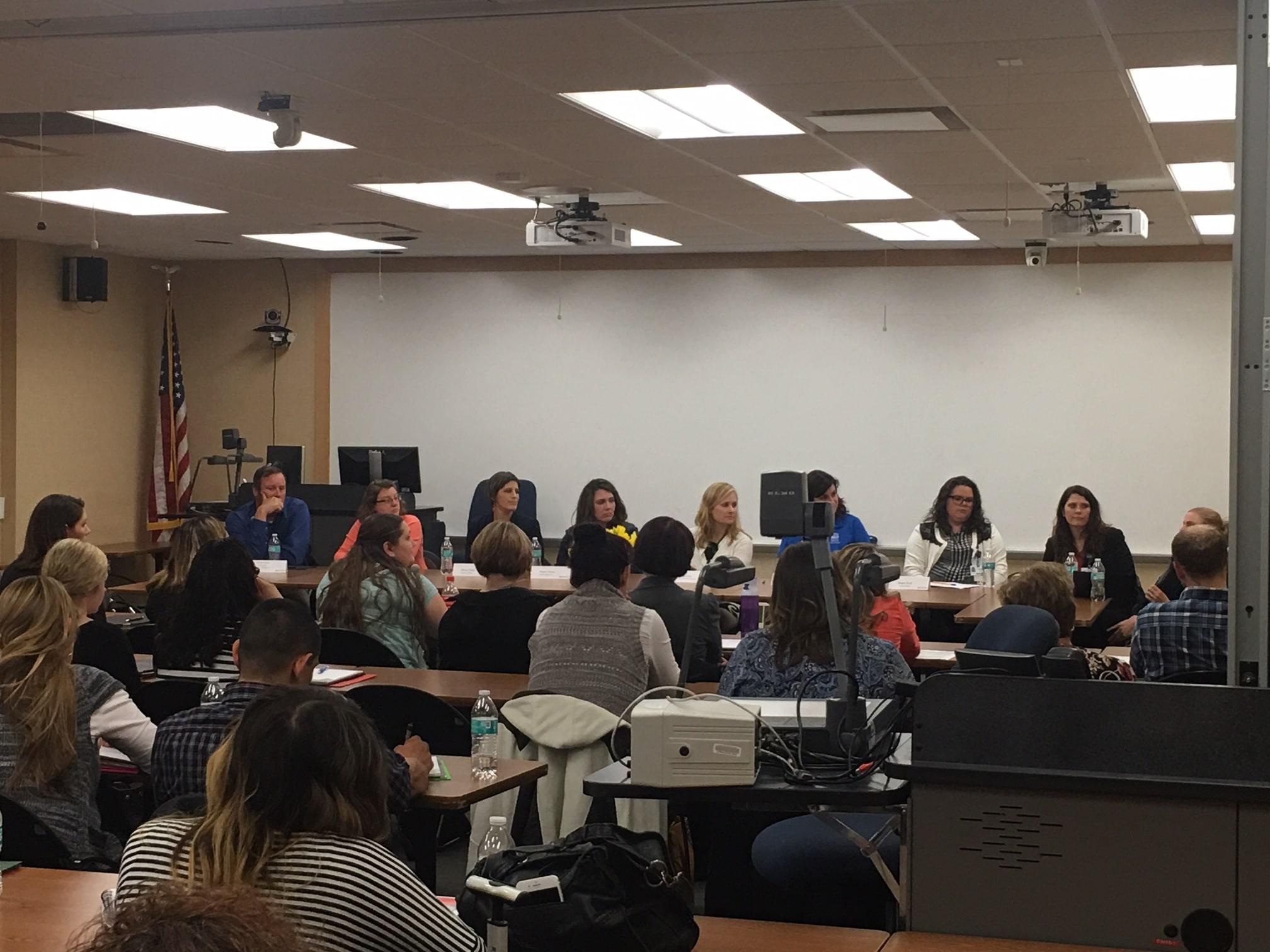 attendees listen to local employers speak