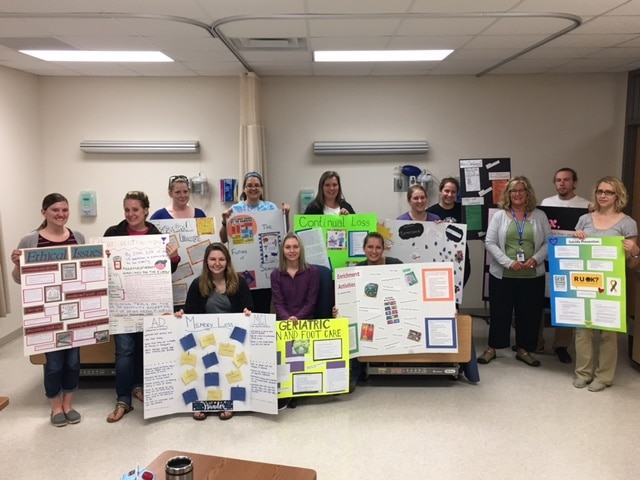 Moraine Park Nursing students displaying posters on healthcare