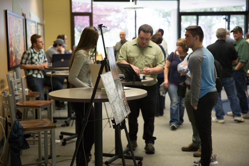 Moraine Park portfolio showcase attendees in cafeteria