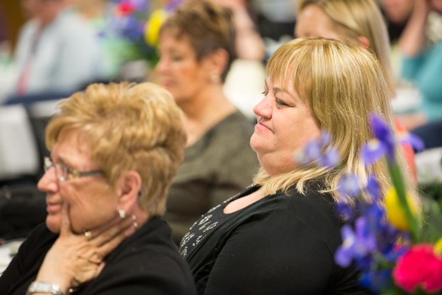 Retiree watching at Retirement-Service Recognition ceremony