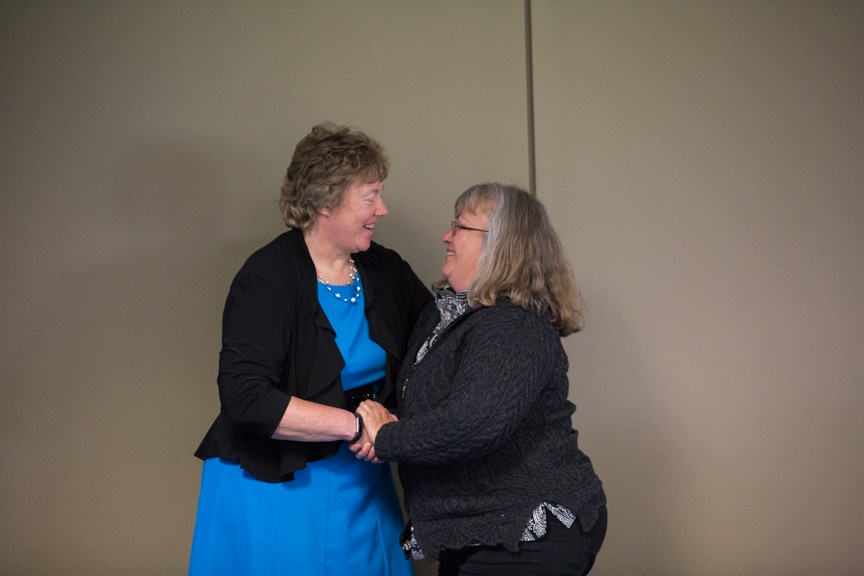 Bonnie Baerwald shaking hands with retiree at Retirement-Service Recognition event