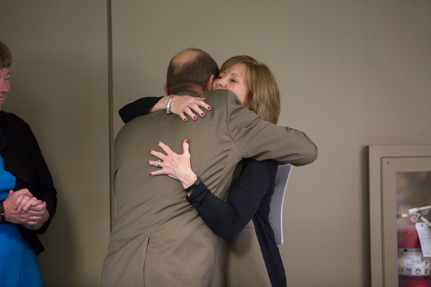 Annie Sabel hugging Jim Eden at Moraine Park Retirement Service Recognition event