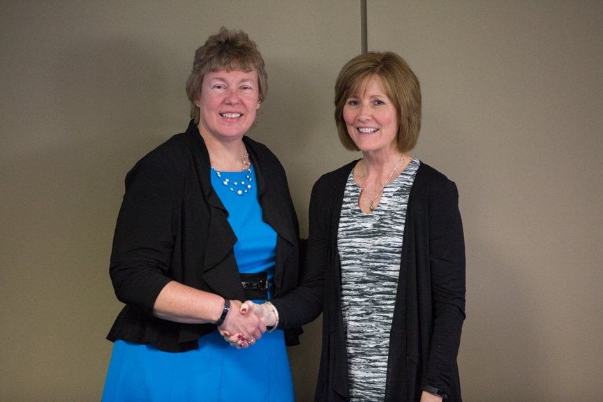 Bonnie Baerwald shaking hands with Annie Sabel at Moraine Park Retirement Service Recognition event