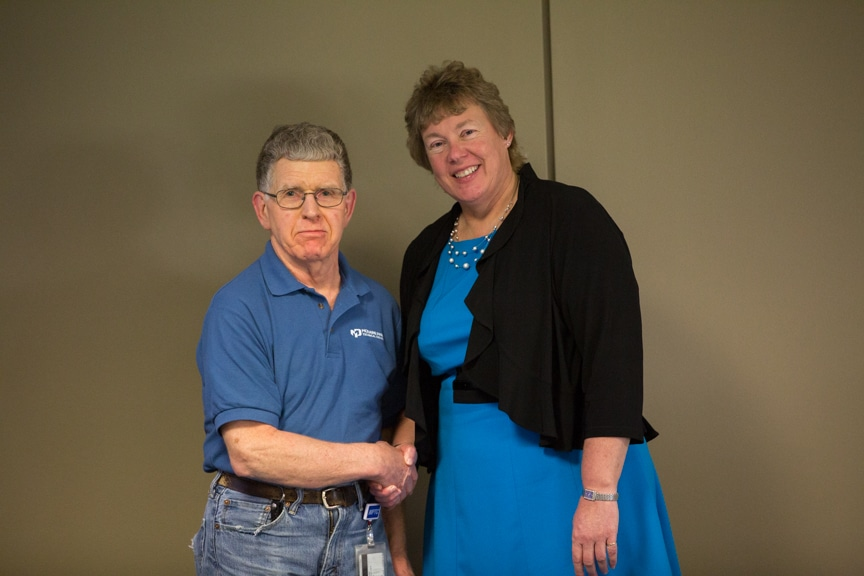 Bonnie Baerwald shaking hands with retiree at Moraine Park Retirement Service Recognition event