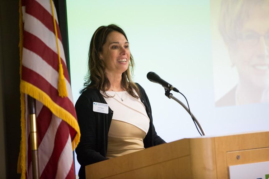 Lisa Pollard speaking at podium at Moraine Park Retirement Service Recognition event