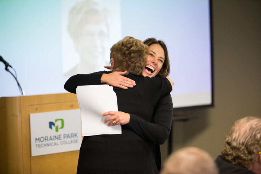 Lisa Pollard hugging Joan Seichter at Moraine Park Retirement Service Recognition event