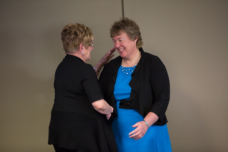 Bonnie Baerwald shaking hands with Joan Seichter at Moraine Park Retirement Service Recognition event
