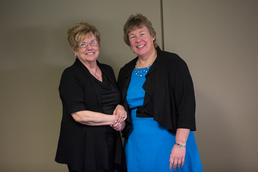 Bonnie Baerwald shaking hands with Joan Seichter atMoraine Park Retirement Service Recognition event