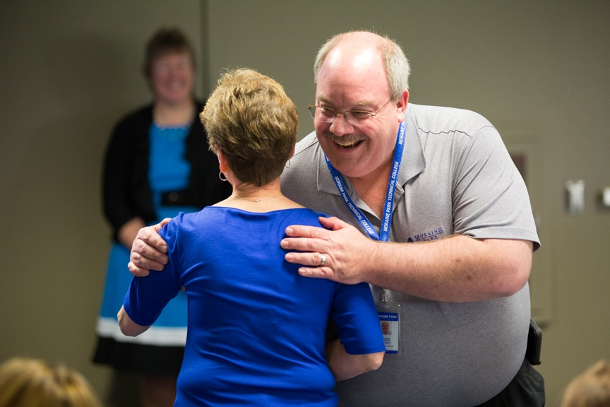 Moraine Park employees hugging during Moraine Park Retirement Service Recognition event